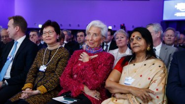 International Monetary Fund director Christine Lagarde (centre) listens to Donald Trump's speech.
