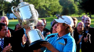 Jason Dufner of the United States celebrates with the Wanamaker Trophy after his victory at the PGA Championship this year.