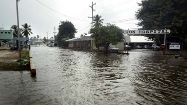 Wet, wet, wet: Tropical downpours have caused flooding and damage in Nauru's detention centre.