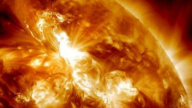 This January 23, 2012 image provided by NASA shows an M9-class solar flare erupting on the Sun's north-eastern hemisphere.