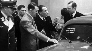 Berlin pitch ... Louis Renault (centre) presents a car built by his group to, from left, Luftwaffe chief Herman Goering and the leader of Nazi Germany, Adolf Hitler, in 1937.