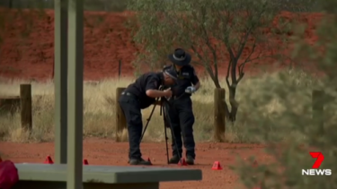 Police investigate at the scene of a stabbing death in the Northern Territory.