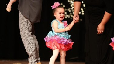 An unhappy Ballerina from Tiny Tutus during her recital at Turramurra High School hall.