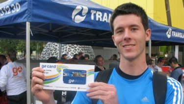 Wishart commuter Jono Webb picks up his free Go Card from one of Translink's 10 public giveaway events.