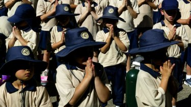 Students from St Fiacre's Primary School in Leichardt praying for the Pope.