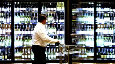 Coles and Woolworths in Alice Springs will not sell any two-litre cask wine from Friday.