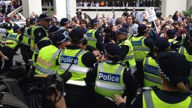 Students face off against police.