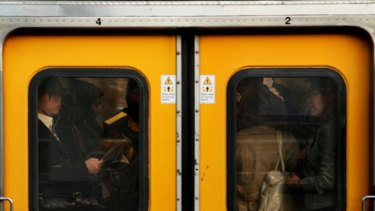 Commuter crush... standing room only as passengers squeeze up for the evening journey home from Town Hall.