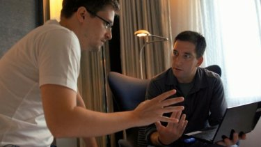 Edward Snowden, left, and Glenn Greenwald in the documentary <i>Citizenfour</i>.
