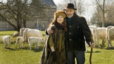 Down on the farm: Isabelle Huppert and Jean-Pierre Darroussin are no country bumpkins in <i>Folies Bergere</i>.