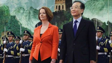 Julia Gillard and Chinese Premier Wen Jiabao review an honour guard during a welcoming ceremony in the Great Hall of the People.