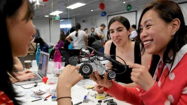 Plugging the braindrain: Tiffany Leung, Georgina Wilcox and Angela Lui, finalists in this year's Anita Borg Memorial Scholarship, at a Google robot workshop.