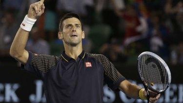 Novak Djokovic celebrates after defeating Stanislas Wawrinka of Switzerland to enter the quarter-finals.