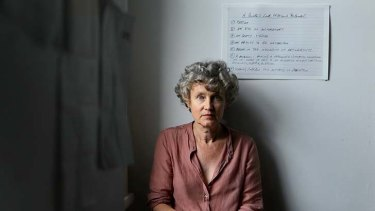 Moving story: Juliet Darling at her home in Woollahra with Nick Waterlow's last will and testament, 7 points of what it takes to be a great art director on the wall behind her. Darling deals with grief in <i>A Double Spring</i>.