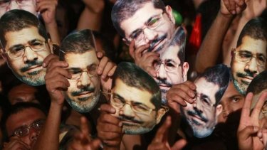 Members of the Muslim Brotherhood and supporters of deposed Egyptian President Mohamed Mursi at a protest in Cairo on July 12, 2013.