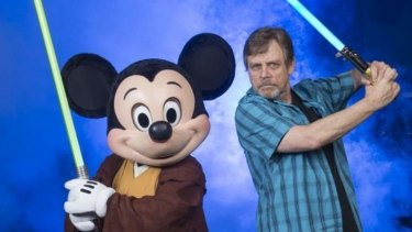 Mickey Mouse and Mark Hamill, the original Luke Skywalker, pose with light sabres to promote a <i>Star Wars</i> weekend at Disney Studios.
