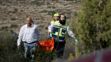 Israeli rescue workers carry the body of US tourist Christine Logan after she was found in a wooded area near the village of Mata, outside Jerusalem.