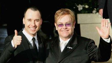 Proud fathers ... David Furnish and Elton John.