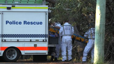 Police rescue crews arrive at the scene in the Blue Mountains where the body was discovered.