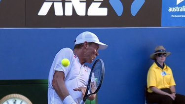 Tomas Berdych is hit in the elbow by a ball returned at him by Nicolas Almagro.