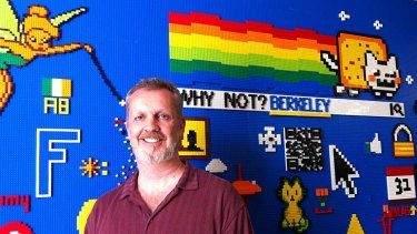Searching for answers ... Lars Rasmussen in front of the Lego wall at Facebook's headquarters.
