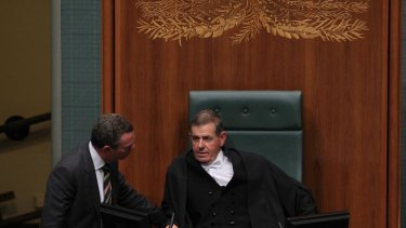 Speaker of the House Peter Slipper talks with opposition frontbencher Christopher Pyne during question time in Parliament yesterday.
