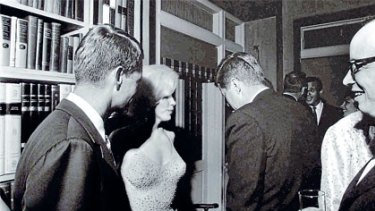 Marilyn Monroe with President John F. Kennedy (right) and his brother Robert, then US Attorney-General.