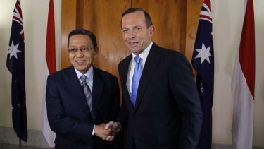 Policy changes: Prime Minister Tony Abbott greets Indonesian Vice President Dr Boediono in Canberra to discuss increased intelligence sharing arrangements.