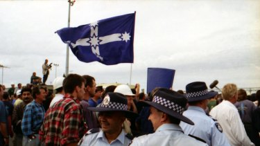 Police and protesters mingle at Webb Dock, Melbourne. April 8, 1998.