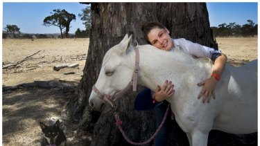 VCE student Ellie McLean is undertaking a VET subject, equine studies, and hopes to become a vet. She is pictured with Jess the dog and Dot the pony.
