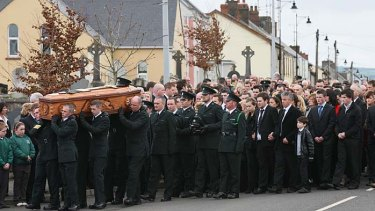 Police officers carry the coffin containing the remains of their colleague Ronan Kerr.