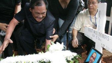 Destroyed ... Vikto Mocodumpis at his son's grave.