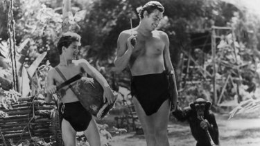 The late Johnny Weissmuller as Tarzan with Johnny Sheffield as Boy and the chimpanzee Cheeta.