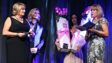 Charlotte Dawson's sisters Vicky Dawson and Robin Barclay accept an honorary ASTRA Award from Sarah Murdoch on behalf of their sister.