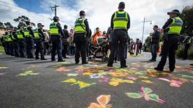 Butterflies and protesters rally for refugees in Eltham.