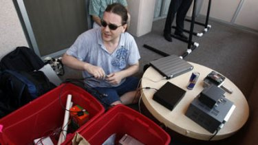 Hacker Chris Paget sets up a long range RFID reading device at the DefCon hacker conference in Las Vegas.