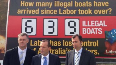 """Tony Abbott's tweeted pic of his launch of a """"stop the boats"""" billboard in Perth."""