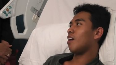 Broken jaw, smashed teeth ... Ashraf Haziq speaks from his hospital bed in a video posted on YouTube.