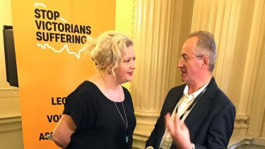 Euthanasia advocate Andrew Denton (right) speaks with Victorian Health Minister Jill Hennessy at Victorian Parliament.