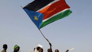 Chance for change ... a woman raises the southern Sudanese flag at a pro-independence rally.