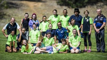 Ex Brumbies and Wallabies player Andrew Walker with the Melba Copland Secondary School handball team at the Inaugural Buroinjin Challenge to raise awareness of Indigenous suicide.
