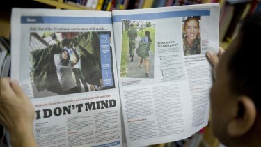 The controversial photo of a maid carrying a soldier's bag for him appeared in the Singapore press.