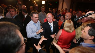 Michael Caltabiano celebrates with Campbell Newman after the latter's 2012 election victory.