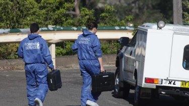 Police forensics leave the scene in Mosmon.