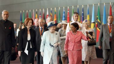Walk and talk ... the Queen leaves the CHOGM meeting yesterday with Julia Gillard and the Prime Minister of Trinidad and Tobago, Kamla Persad-Bissessar.