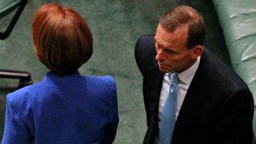 Tension ... Prime Minister Julia Gillard passes Opposition Leader Tony Abbott.