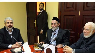 The leader of Hamas Khaled Meshaal, left, meets with Supreme Leader of the Muslim Brotherhood Mohamed Badie, centre, to congratulate him on the party's victory in the Egyptian parliamentary elections on Saturday.