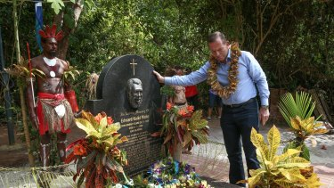 Prime Minister Tony Abbott lays a wreath at the grave of Eddie Mabo.