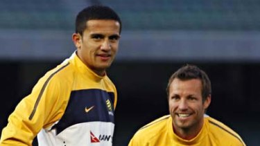 Socceroos Tim Cahill (left) and captain Lucas Neill at the MCG yesterday.