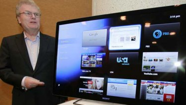 Sony CEO Howard Stringer stands near a Google TV display. Photo: AP/Paul Sakuma